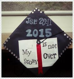 """My personalized college graduation cap: Jer. 29:11......2015......and an open book with the words """"My Story Is Not Over!"""" I'm an English major & a writer so this was just the right design for me. :) The Bible verse goes perfect with the theme too: """"For I know the plans I have for you', declares the Lord, 'plans to prosper you and not to harm you, plans to give you hope and a future.'"""" Jer. 29:11"""
