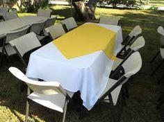 Budget friendly white plastic table cloths with yellow and purple plastic cloths on top?