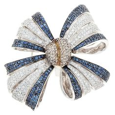 Broche lazo en oro y pedrerí - gorgeous bow brooch in diamonds and sapphires.