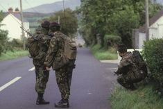British Soldiers patrol a road leading out of the Irish Republican stronghold of Crossmaglen, September 1985