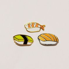 Set of 3 sushi pins- Salmon, Tamago, and Shrimp (Ebi). 3/4 hard enamel polished silver and gold plated lapel pins with butterfly clasp backings.