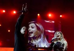 """A year after performing for the big game at the Superdome in New Orleans, Beyonce performed for a smaller crowd Saturday night as Jay Z brought his wife out for a surprise cameo during his concert for DirecTV's """"Super Saturday Night"""" party on the eve of the Super Bowl."""
