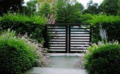 Black Gate: Love black fencing in a modern garden