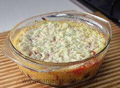 Baked Gajar Halwa with Gulab Jamun Recipe - Small gulabjamuns topped with gajarhalwa and baked