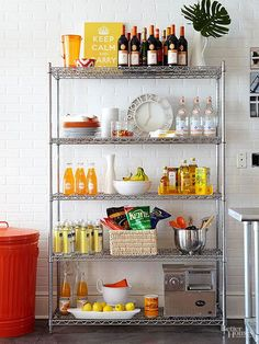 Employ an industrial metal shelving unit as extra kitchen storage if your apartment's kitchen storage options are less than generous. The cool finish of this unit recalls metal touches that are standard in pro kitchens. Use baskets to corral kitchen staples, and incorporate a few decorative touches to keep it fun.