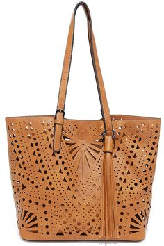 "Take the Party Flavor Tan Tote on your next beach outing and you'll be sure to get some attention! Laser-cut vegan leather tote has a sturdy, flat-bottom, plus a cute hanging tassel. Mini bag houses smaller essentials thanks to a fabric-lined interior with three side-wall pockets. Tote handles have a 10"" drop."
