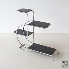 Tubular steel streamline etagere of the 30s ... this is so me it's almost not funny.