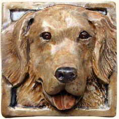 Ceramic relief hand painted dog tiles, dog tile shower, bath, dog tile portraits, handcrafted and handmade dog prints, relief dog biscuits, dog paw tiles, dog bone tiles