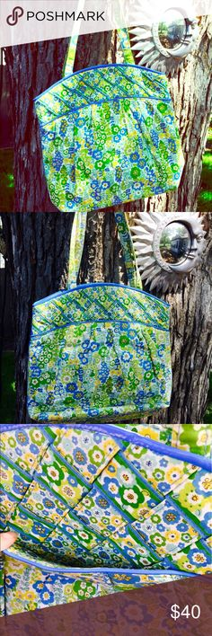 Vera Bradley Tote This is one roomy tote!! With gorgeous basket weave fabric lined by bright blue patent leather. So pretty. Vera Bradley Bags Totes