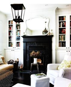 Suzie: House & Home - Ingrid Oomen - Chic small living room design with white built-ins, . Black fireplace and mantle, white slipcovered chairs Living Room Furniture Layout, Living Room Designs, Living Room Decor, Bedroom Furniture, Living Rooms, Apartment Furniture, Men Bedroom, Living Room Storage, Family Rooms