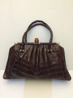 stunning 1940's alligator purse with a bakelite top in perfect condition