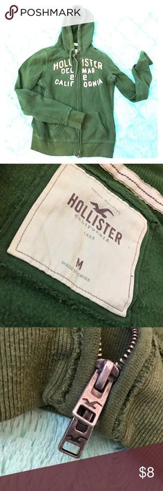 Army Green Hollister Hoodie Women's Army Green Hollister Hoodie Size: M ; has Hollister printing on the front of the hoodie; had this hoodie for awhile but still in good condition; only thing is the zipper sometimes gets stuck at the bottom when trying to unzip it; nice warm n comfortable hoodie Hollister Jackets & Coats