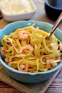 This Parmesan Garlic Shrimp Fettuccine is made in under 20 minutes and is filled with shrimp, fresh Parmesan, and a light garlic sauce.