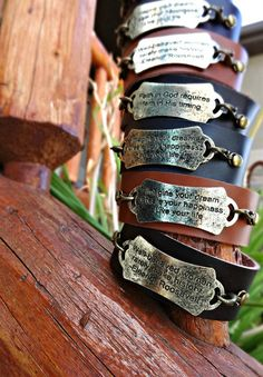 Leather and Stamped Metal Saying Cuffs.