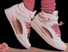 LA Gear, I had hot pink and silver ones with the three pairs of laces (white, pink and glittery silver) that I wore all at the same time LOL