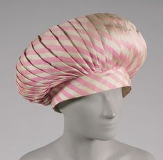 Woman's hat (front view) | Elsa Schiaparelli (Italian, 1890-1973) | France, circa 1950 | Pink and white striped silk plain weave | Philadelphia Museum of Art