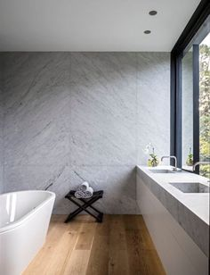 COLOUR COMBINATION Timber floor, concrete look porcelain panel wall (no grout), matching benchtops and white vanity cabinetry.  Would look good with black tapware too.