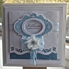 base layers Spellbinders grand squares and embossed the top one with my favourite Sue Wilsons folder heart lattice. Also used SB bracket border 1, Made a frame using SB labels twenty and classic oval and the stamp set to match from justrite called 'kindness', its actually heat embossed with blue glitter powder which is fab but you cant really see the sparkle on the pic. The dotted frame on the oval is from stamping up. added a blue ribbon bow and another flower hair clip from primark