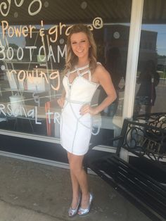 This dress is in our 75% off corner. white cocktail dress with silver detail
