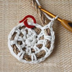 Crochet on rope. I may have to try this with rope and string for a doormat.