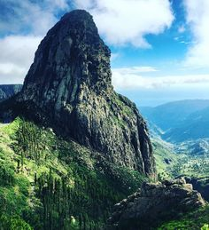 Roque de Agando, Canary Islands, Spain.  Roque de Agando is a prominent rock formation on the island of La Gomera in the Canary Islands. It is one of La Gomera's most striking features and is frequently used as a symbol for the island.  Photo by bigecco via Instagram #amitrips #travel #nature #trip
