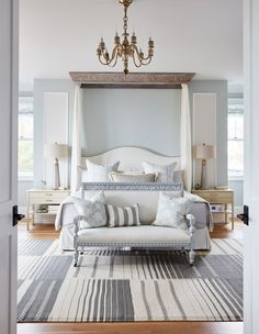 Traditional design and classic decor in a bedroom by Sarah Richardson with tranquil blue grey painted walls, canopy over bed, and blue stripe rug. This is Sarah's own bedroom in her Toronto off the grid house. Chambre Sarah Richardson, Sarah Richardson Home, Richardson Homes, Sarah Richardson Farmhouse, Coastal Master Bedroom, Master Bedroom Design, Home Decor Bedroom, Bedroom Kids, Modern Bedroom