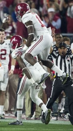 Alabama defensive back Eddie Jackson (4) and Alabama defensive back Ronnie Harrison (15) celebrate an interception during Alabama's College Football Playoff National Championship football game with Clemson, Monday, Jan. 11, 2016, at University of Phoenix Stadium in Glendale, Ariz.
