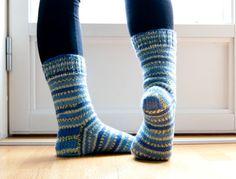 Hand knit socks in stripes in skye blue.
