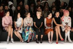 The in crowd: Kendall sat up straight as she posed on the front row...