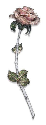 A DIAMOND, PINK DIAMOND, DEMANTOID GARNET AND PINK SAPPHIRE ROSE BROOCH, BY MICHELE DELLA VALLE Realistically designed with pavé-set pink diamond and pink sapphire petals to the demantoid garnet undulating leaves and pavé-set diamond stem with thorns, mounted in 18K white and yellow gold