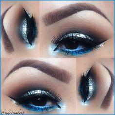 Blue eyeshadow underlining the eye, silver on top lid, gray& mauve in crease of lid. Skin Makeup, Makeup Art, Makeup Tips, Makeup Ideas, Dallas Cowboys Makeup, Homecoming Makeup, Prom Makeup, Beautiful Eye Makeup, Blue Eyeshadow