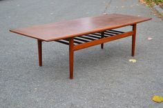 Large mid century Danish teak coffee table designed by Grete Jalk for Glostrup in the shape of a surfboard. Mid Century Coffee Table, Coffee Tables, Surfboard Coffee Table, Ping Pong Table, Mad Men, Mid-century Modern, Family Room, Furniture Design, Home Decor