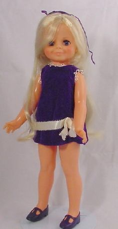 Loved the Velvet Doll. Push a button on her belly and her hair pulled out of the top of her head. Turn the button on her back and it wound back up. 1969ish. Wish I knew how to post a picture of my own mint condition Velvet and Crissy.