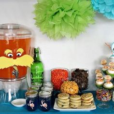 Oh my goodness! I love the Lorax punch thing! The Seuss Shower is just an idea. I know Sara mentioned wanting books for Elli and originally she looked at Seuss Bedding. I'm going to call her later to see if she wants something specific or wants to be surprised.