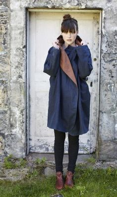 Navy Waxed Cotton Raincoat from Plumo. The picture is done so well.