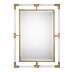 """This mirror can certainly serve as a focal point for any room. Combining hand forged iron, finished in lightly antiqued gold leaf, with suspended solid, clear acrylic bars creates a modern feel. Mirror has a generous 1 1/4"""" bevel. May be hung horizontal or vertical.  Dimensions: 28 W X 38 H X 1 D (in)  Reserve yours now! Available 3/9/2017!"""