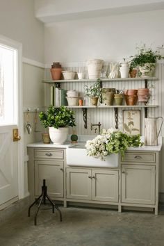 The Garage Turned Garden Shed- Storage Ideas