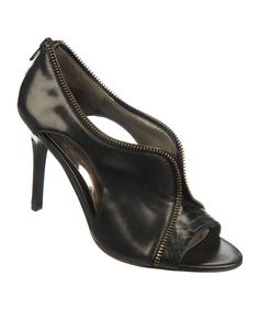 Sleek, sassy and beautifully bold, these posh pumps are a step ahead. Boasting a luxe leather construction with edgy zipper detailing and a pretty peep toe, these chic shoes add a dash of daring to any ensemble.3.5'' heelZipper closureLeather upperRubber soleImported