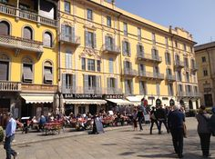 First hint of spring and locals flock to outdoor bars and restaurants. This shot taken in Piazza Cavour ~ Como, Italy