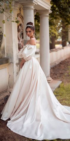 Stunning Off-the-Shoulder Wedding Dress with Puffy Sleeves #weddingdress #wedding #weddingdresses #bridal #bridaldresses #weddinggowns