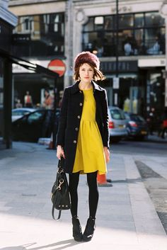 Beat the winter doldrums with a bright, canary yello dress (and a fur hat)!