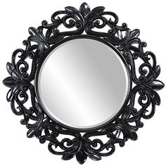 This glossy black contemporary mirror will enlighten your decor with sophistication. This beveled wall mirror has an ornate decorative frame.