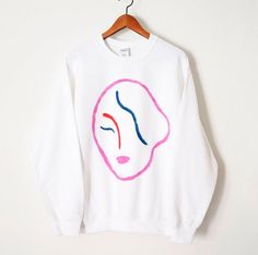 These silkscreened sweaters feature a multicoloured modern face in the vein of Matisse or Picasso. It was silkscreened by the artist in their studio in Toronto, Canada, on a heavy weight, super soft fleece lined sweater. Matisse, Street Style, Mode Style, Pull, Graphic Sweatshirt, Trending Outfits, Sweatshirts, Etsy, Face