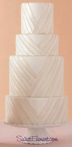 Like the variation in height of the layers. Makes it feel very grand.   Also love the woven detail and *subtle* iridescence and color.  Hate fondant though.