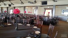 Corporate Gala at Palais Royale. | Peppermint Weddings | Toronto Weddings | Black and Red centerpiece | Red orchids | Tall Skinny euro eiffel vase black | Corporate Gala Bold Theme