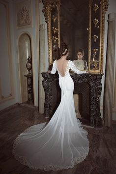 This designer makes me want a gown with sleeves! So elegant!