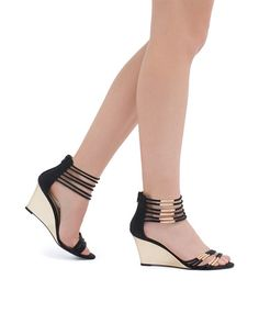 Gold tubing adorns each strap on these glam wedges.