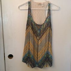 Top Very colorful sleeveless top. Has gold threading throughout the front, the back is a mess style. Daytrip Tops Tank Tops
