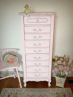 This pretty French provincial piece has been refinished and painted in a soft pink and distressed. It features one smaller drawer at the top and five deeper drawers underneath with original hardware. This chest would be a perfect piece in any shabby chic bedroom.