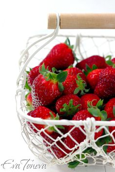 strawberries just picked in white wire wooden handled basket